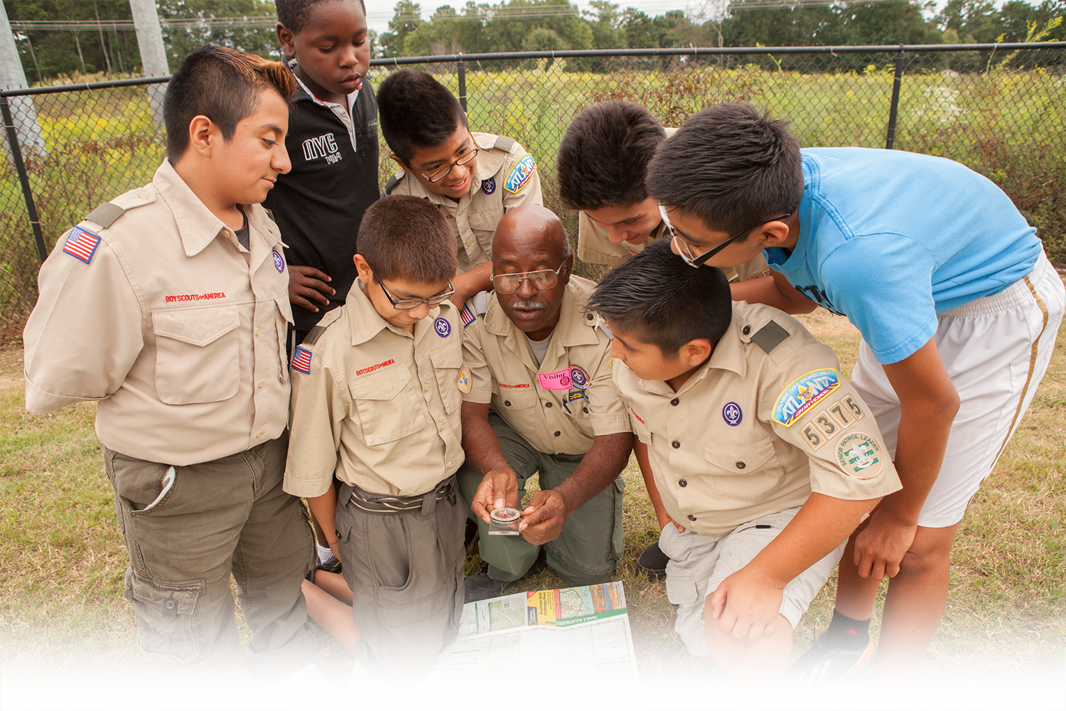 A Program Specialist teaches Scouts how to use a compass