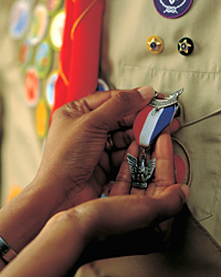 Close up of an Eagle Scout pendant on a Scout's uniform