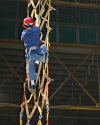 A Scout climbs up a weaved ladder at the 2007 Scout Show