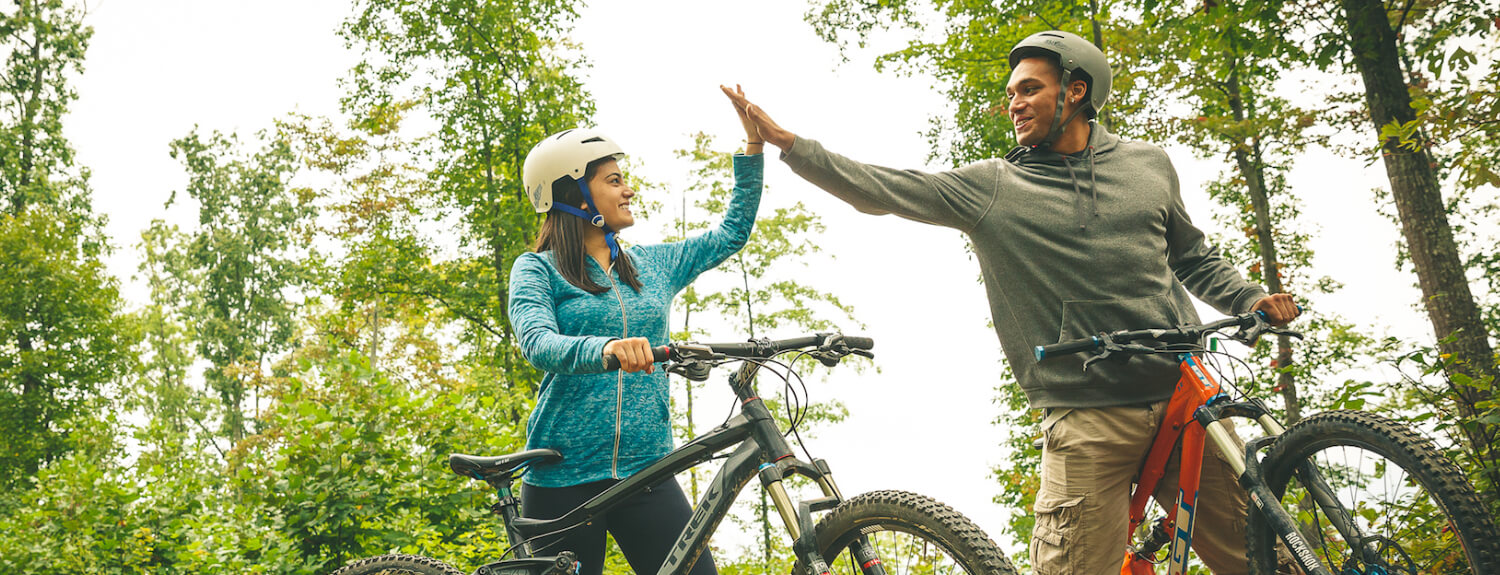 Venturers high-five on a biking trip