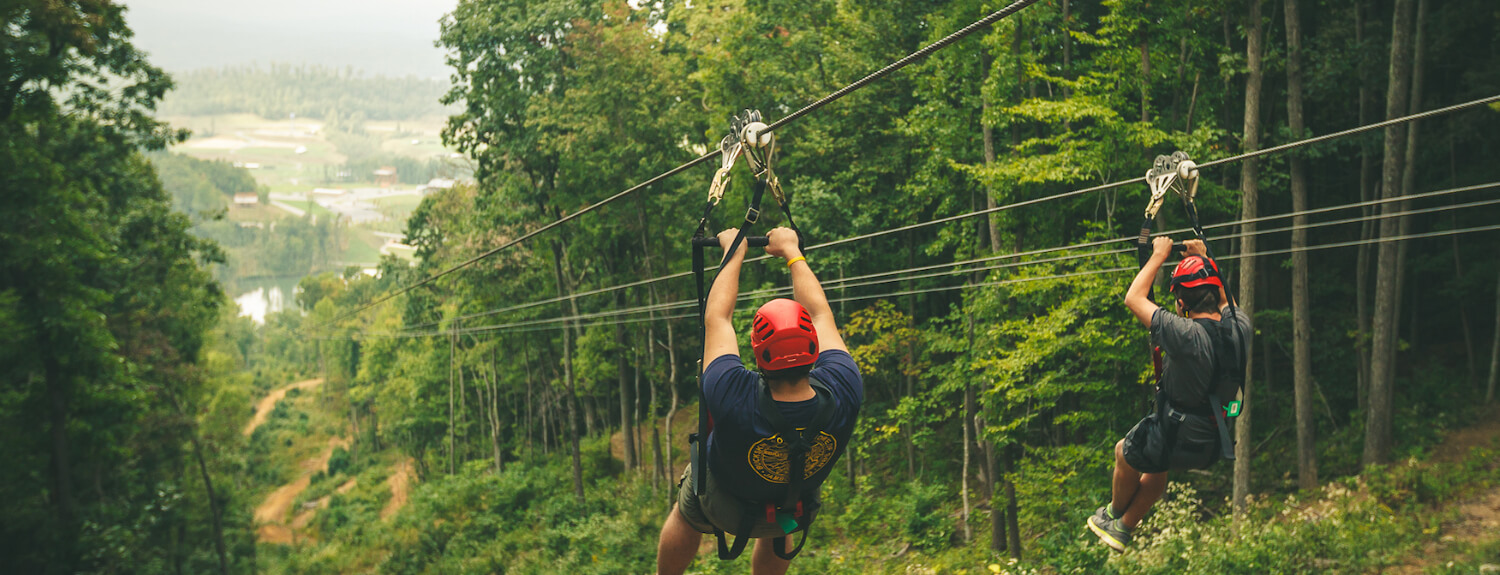 Scouts zip-line down a mountain